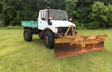 1987 Unimog U1250v w/ Schmidt 12.5 4 section plow